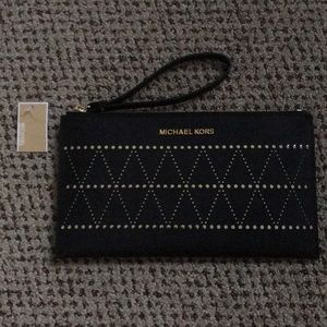 Brand new Michael Kors large leather clutch